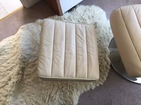 Cream Leather swivel Chair and Matching Footstool.