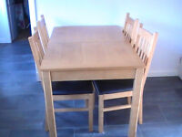 wooden dininig table and 4 chairs. Middle section to make table bigger also