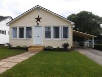 COZY WELL MAINTAINED BUNGALOW PRICED TO SELL!