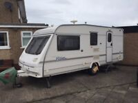 Sterling Vitesse tourer. 4 berth end bathroom. Extras include awning motor mover alco tow hook