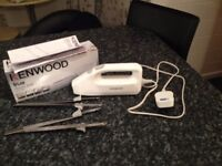 Kenwood Electric Knife with 2 sets of blades. Almost new.