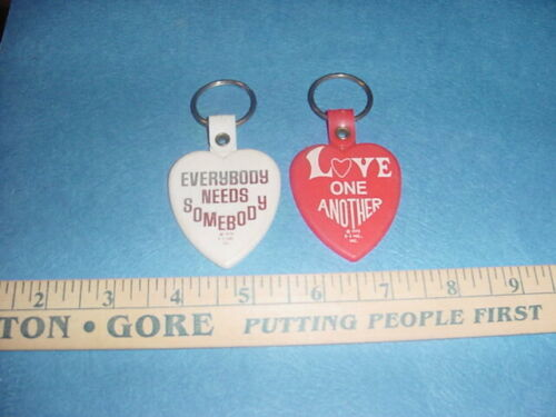 VINTAGE 1975 PEACE KEYCHAIN LOT OF 2 LOVE ONE ANOTHER EVERYBODY NEEDS SOMEBODY