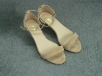 Nude sandals, size 7.