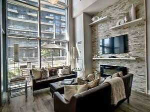 2 Storey Townhouse Loft Unit Featuring A Soaring 12 Foot Ceiling