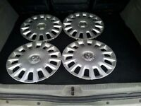 Four 14inch vauxhall wheel trims