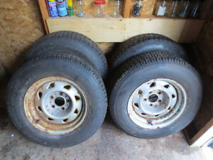 4 Uniroyal tires studded on rims