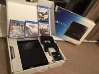 PLAYSTATION 4 BLACK 500GB GOOD CONDITION WITH TWO DUAL SHOCK 4 CONTROLLERS AND 4 GAMES