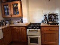 Kitchen cupboards, sink, water tap, worktop etc