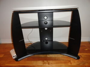 t.v.stand with 3 glass shelves