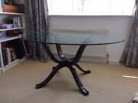 Glass topped round dining table 1.5 m diameter