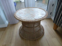 Coffee table with rattan base and tile top. Good condition.