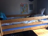A sturdy full size single, mid sleeper bed in good quality pine. Has an integrated desk/ shelf.