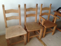 4 Solid heavy chairs including 1 carver.
