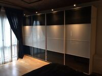 Ikea Pax Wardobes - black and white glass doors 200cm x 236cm
