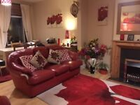Red Leather Sofa for Sale (priced) in Edmonton N9