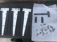 A set of three 12 inch T-hinges and a cast iron latch for a cottage style door