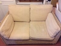 Two seater cream sofa with washable covers