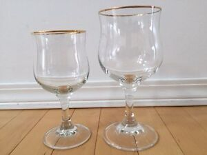 Crystal wine glasses, rimmed with gold