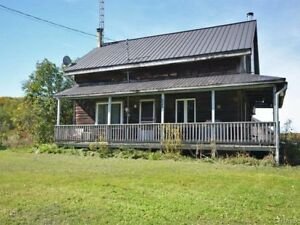 Log house with 4 bedrooms on a 1/2 acre of land