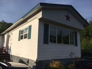Mobile home sitting on 2.4 Acres with Large Garage!