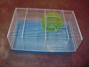 Hamster cage with wheel for sale.