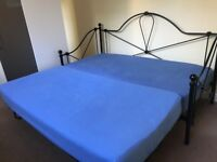 Black metal guest bed
