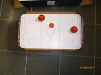 Tabletop air hockey, boxed