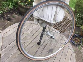 Shimano 105 700c road bike wheel with a Mavic rim