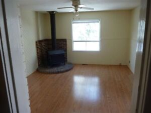large 3 bdrm home/garage/family room & private fenced yard