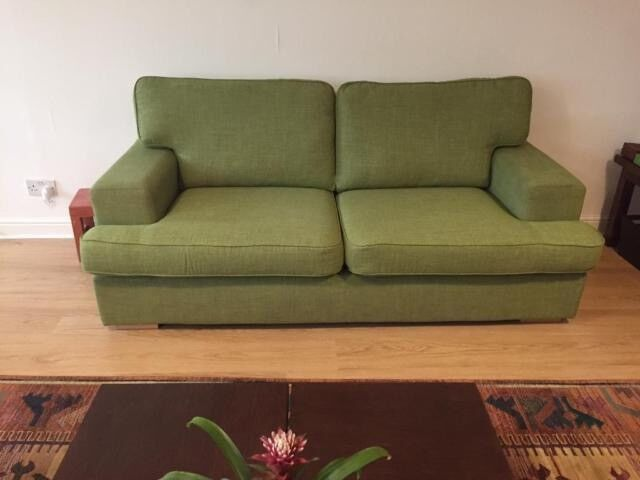Green sofa in excellent condition