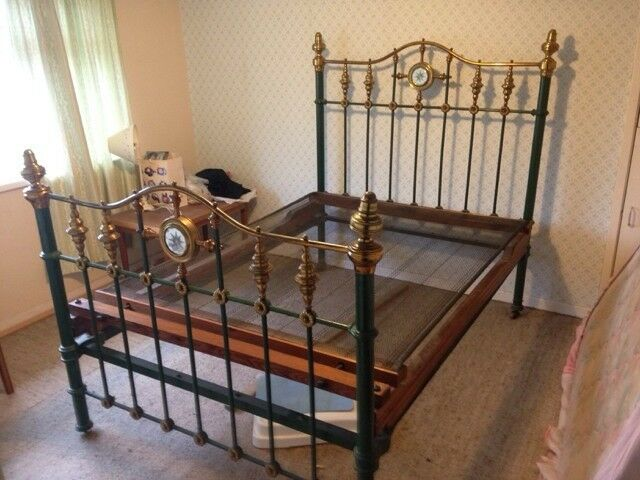 A Victorian Brass And Iron Twin Bed With Wooden Frame In