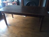 Solid wood table, antique look.