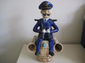 Comical Porcelain Decanter Of A Sea Captain Sitting On A Barrel. OFFERS WELCOME.