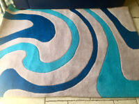 Rug with a blue and teal abstract pattern