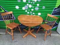 FOLDING ROUND WOODEN TABLE & 2 WOODEN CHAIRS