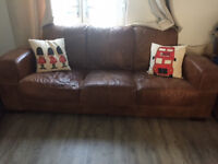 2 * 3 seater brown leather sofas.