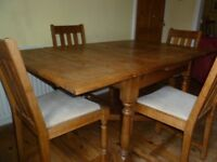 Solid oak dining table (extendable) and 4 chairs - in good condition, and seats 4 - 6 people