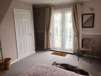Double room in Cirencester with private garden & parking