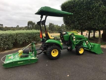 John Deere 1023E Tractor & Equipment