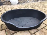 Dog bed - durable, black plastic, for a medium sized dog. Bed measures 80x55cm. Buyer to collect.
