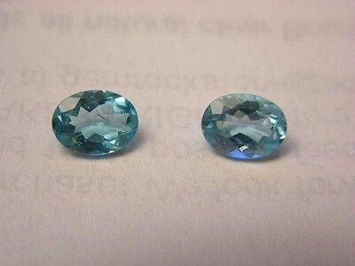 Apatite gemstone pair bright neon Paraiba blue faceted 8x6 oval 1.25 ct each