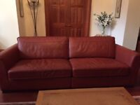 Three and two two seater sofas in rust leather