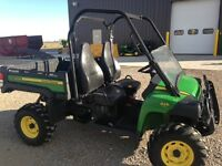 JOHN DEERE 825I GREEN AND YELLOW WITH 791 HOURS