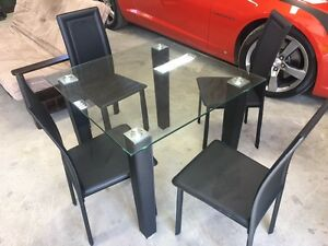 Glass table and chairs in excellent condition.