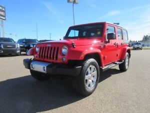 2015 Jeep Wrangler Unlimited Sahara. Text 780-205-4934 for more