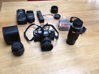 Minolta x-700 camera, three lenses and extras