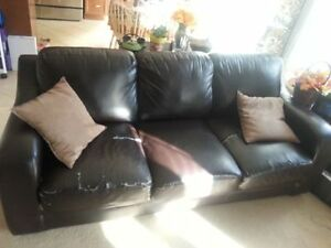 Brown leather couch with queen mattress foldout 150$ as is