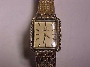 #3121-14k GOLD LADIES OMEGA WATCH-1960`S -IN VERY NICE CONDITION- Estate piece-keeps time- WILL SHIP ONLY IN CANADA-