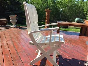 4 adjustable white deck chairs with pads