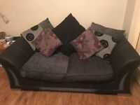 DFS black and charcoal 3 seater and 2 seater sofas with pouffe for sale